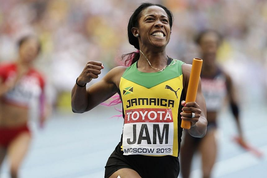 Jamaica's Shelly-Ann Fraser-Pryce reacts after winning the women's 4x100-meter relay final at the World Athletics Championships in the Luzhniki stadium in Moscow, Russia, Sunday, Aug. 18, 2013.