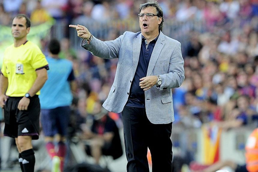 """Barcelona's Argentinian coach Gerardo """"Tata"""" Martino shouts during the Spanish league football match FC Barcelona vs Levante UD at the Camp Nou stadium in Barcelona on Aug 18, 2013. Manager Gerardo Martino hailed Barcelona's """"great performance"""" in de"""