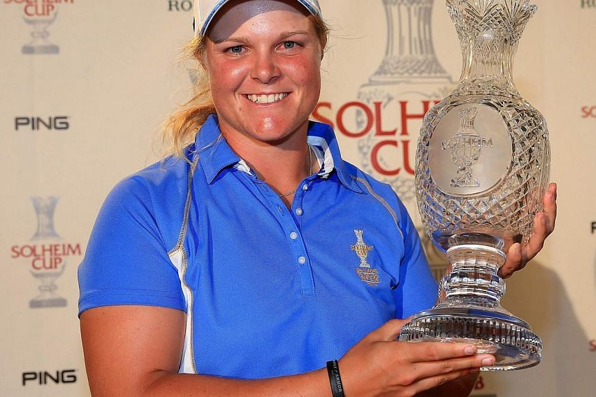 Caroline Hedwall of Sweden and the European Team the first player with a perfect record of five points with the trophy after they had won the match 18-10 during the final day singles matches in the 2013 Solheim Cup at The Colorado Golf Club on Aug 18