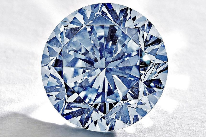 Sotheby's auction house on Monday, Aug 19, 2013, shows The Premier Blue diamond. The diamond will go under the hammer in Hong Kong in October, with auctioneers hoping the sale will fetch a record-breaking US$19 million (S$24 million) despite fears ov