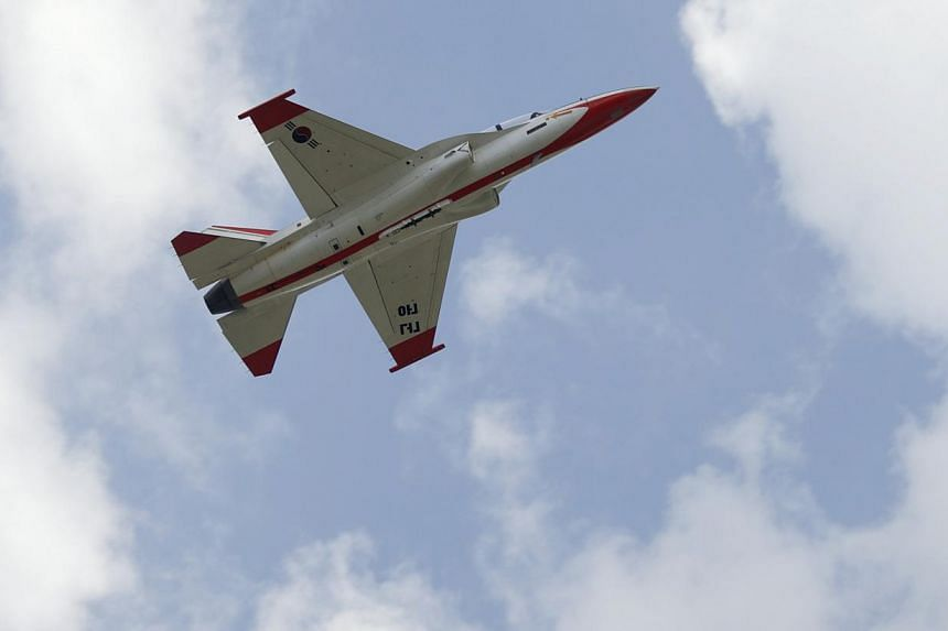 A T-50 advanced jet trainer is seen in the sky during training at the First Fighter Wing of the South Korean air force in Gwangju, about 320km south of Seoul on Aug 14, 2013. South Korea, renowned for making hi-tech consumer devices, cars and ships,