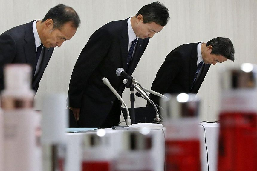 Mr Masumi Natsusaka (centre), president of Japan's cosmetics maker Kanebo, and other executives bow to apologize during a press conference in Tokyo on July 4, 2013. Japanese cosmetics maker Kanebo said on Monday, Aug 19, 2013, the number of complaint
