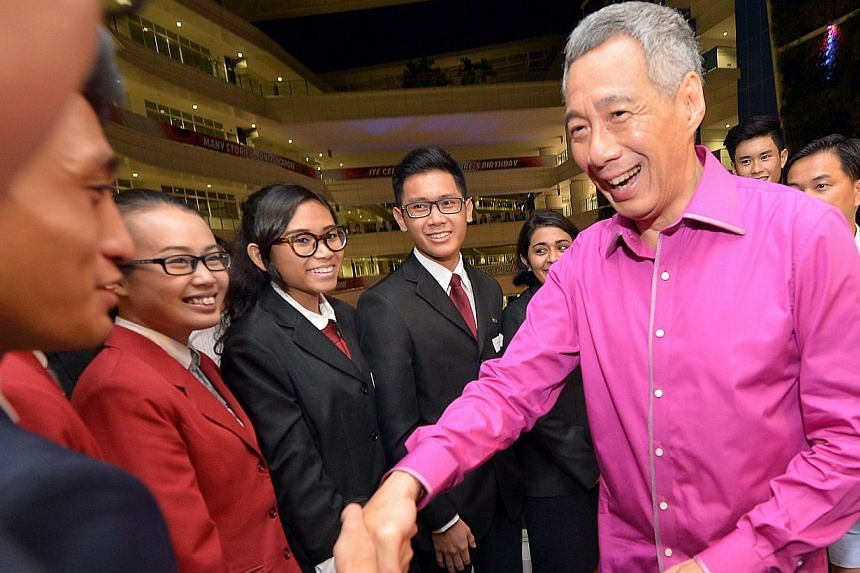 PM Lee meeting ITE students at a reception after his speech yesterday. Mr Lee, who chose to deliver his 10th National Day Rally at the ITE's new Ang Mo Kio campus, said the ITE community had been very supportive of him holding the Rally there and t