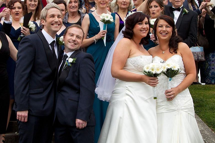 Richard Rawstorn (left) with Richard Andrew (second left) from Christchurch and Jess Ives (right) and Rachel Briscoe (second right) from the Bay of Islands celebrate being married during the first same sex marriage at the Rotorua Museum in Rotorua on