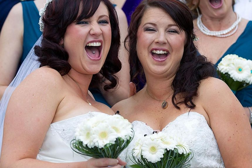 "Jess Ives (right) and Rachel Briscoe (left) from the Bay of Islands celebrate being married during the first same sex marriage at the Rotorua Museum in Rotorua on Monday, Aug 19, 2013. More than 30 same-sex couples will say ""I do"" on Monday when New"