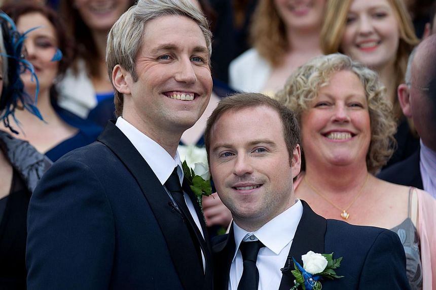 """Richard Rawstorn (left) with Richard Andrew from Christchurch celebrate being married during the first same sex marriage at the Rotorua Museum in Rotorua on Monday, Aug 19, 2013. More than 30 same-sex couples will say """"I do"""" on Monday when New Zealan"""