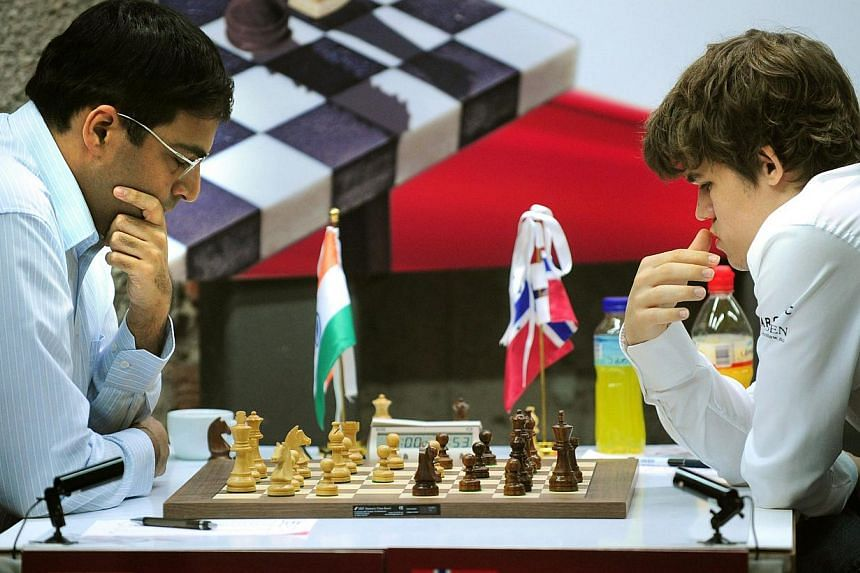 "Norwegian chess player Magnus Carlsen (right) plays against India's Viswanathan Anand during the Bilbao Final Masters 2010 in the northern Spanish Basque city of Bilbao on Oct 15, 2010. Carlsen has inserted an ""illness clause"" in his contract to play"