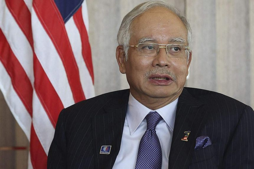 Malaysia's government will not privatise national carrier Malaysian Airlines as efforts to turn its business fortunes around are bearing fruit, Prime Minister Najib Razak was quoted as saying by state media on Monday. -- FILE PHOTO: REUTERS