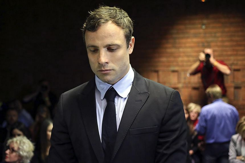 South Africa's Paralympian sprint star Oscar Pistorius will go on trial in March charged with murdering his girlfriend on Valentine's Day, a magistrate ruled at a packed court hearing on Monday. -- PHOTO: REUTERS