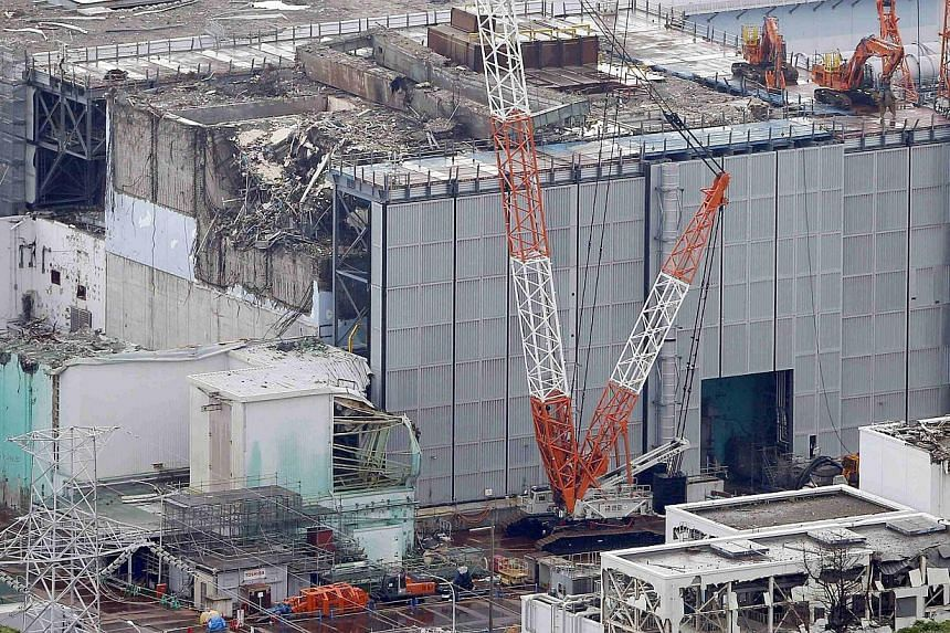 An aerial view shows the No.3 reactor building at Tokyo Electric Power Co (Tepco)'s tsunami-crippled Fukushima Daiichi nuclear power plant in Fukushima Prefecture, in this photo taken by Kyodo on July 18, 2013. Puddles with extremely high radiation l