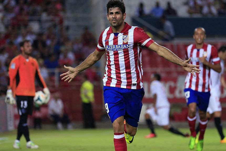 Atletico Madrid's Diego Costa celebrates after scoring against Sevilla during their Spanish First Division soccer match at Ramon Sanchez Pizjuan stadium in Seville on Aug 18, 2013. -- FILE PHOTO: REUTERS