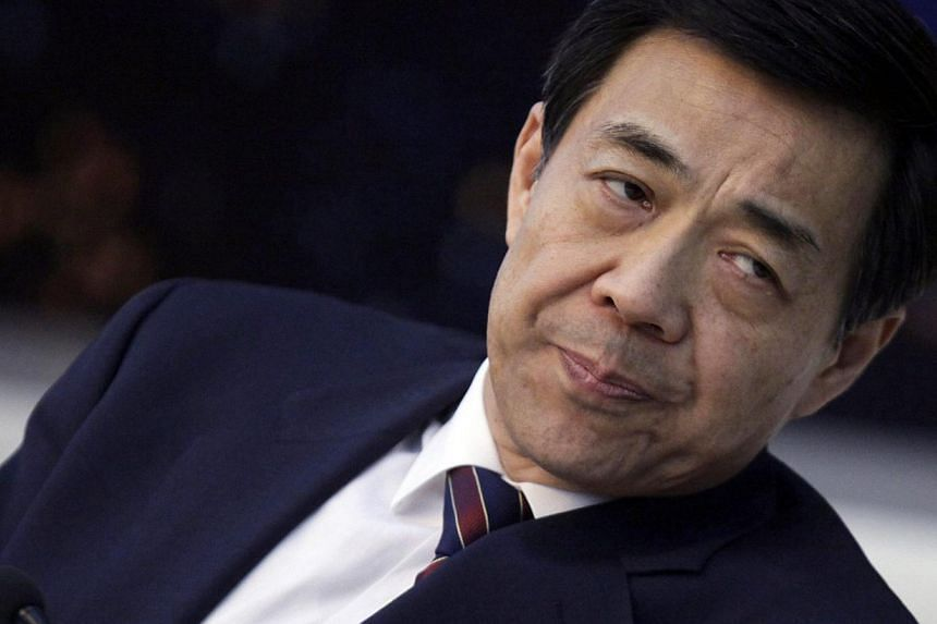 Bo Xilai listens to Chongqing's Mayor Huang Qifan (not pictured) during a meeting at the annual session of China's parliament, the National People's Congress, at the Great Hall of the People in Beijing, on March 6, 2010. Bo's son broke a months