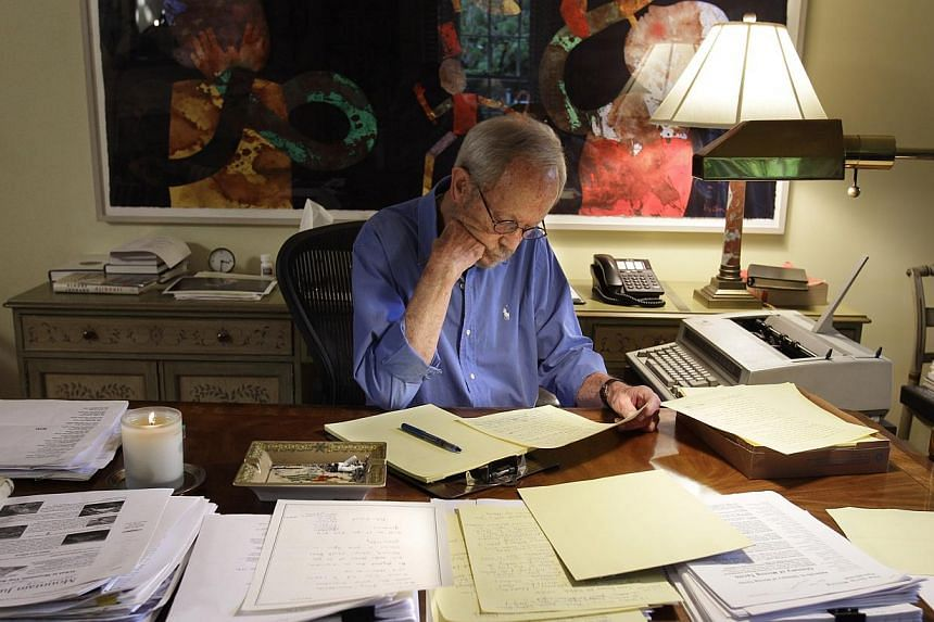 Author Elmore Leonard works on a manuscript at his home in Bloomfield Township, Michigan on Tuesday, Sept 28, 2010. Leonard died on Tuesday, Aug 20, 2013, having suffered a stroke last month, the writer's website said. -- FILE PHOTO: AP