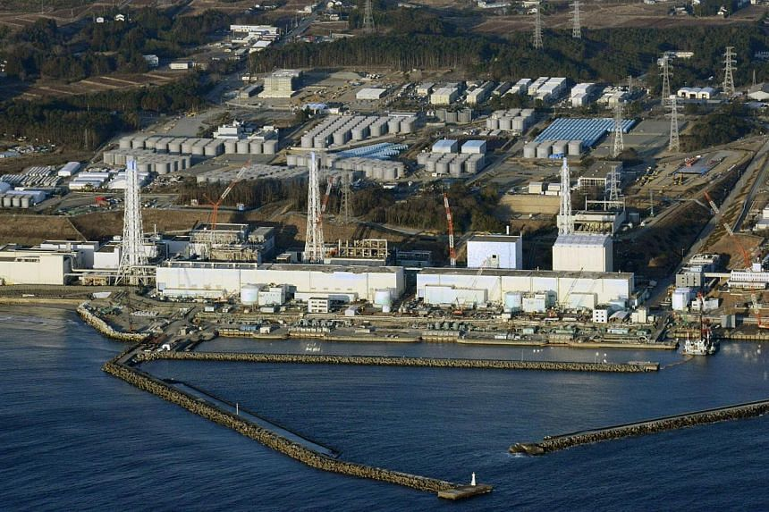 An aerial view shows Tokyo Electric Power Co's tsunami-crippled Fukushima nuclear power plant in Fukushima Prefecture on March 11, 2013. The operator of Japan's crippled Fukushima nuclear plant said on Tuesday, Aug 20, 2013, it believes about 300 ton