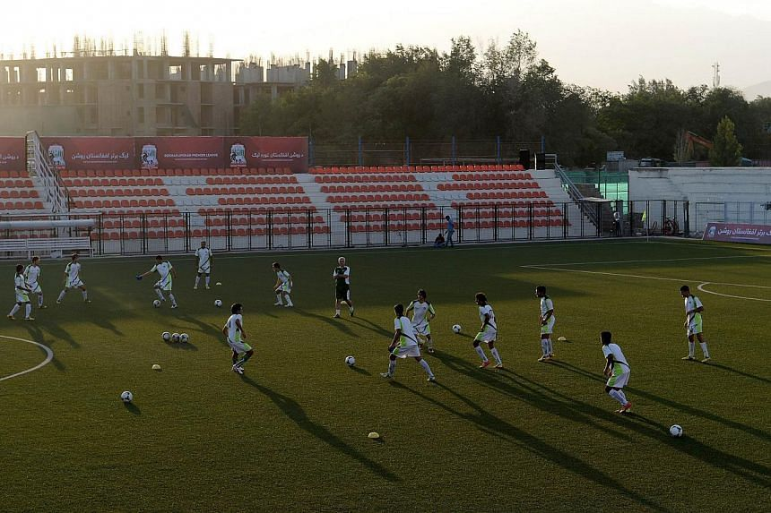 Pakistan football players train at the Afghanistan Football Federation (AFF) stadium in Kabul on Monday, Aug 19, 2013. Afghanistan's football fans on Tuesday, Aug 20, 2013, were eagerly awaiting their first home international for 10 years, preparing