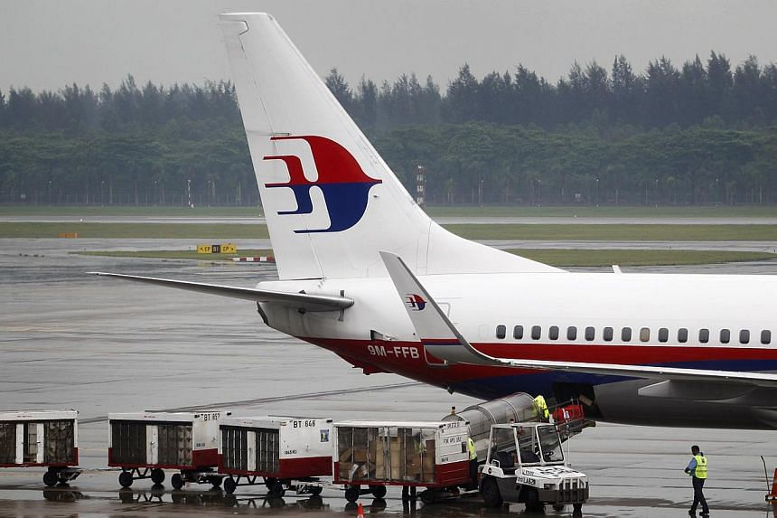 Struggling flag carrier Malaysia Airlines said on Tuesday, Aug 20, 2013, that it has recorded a second consecutive quarterly loss after failing to overcome drag from earlier borrowings. -- ST FILE PHOTO: KEVIN LIM
