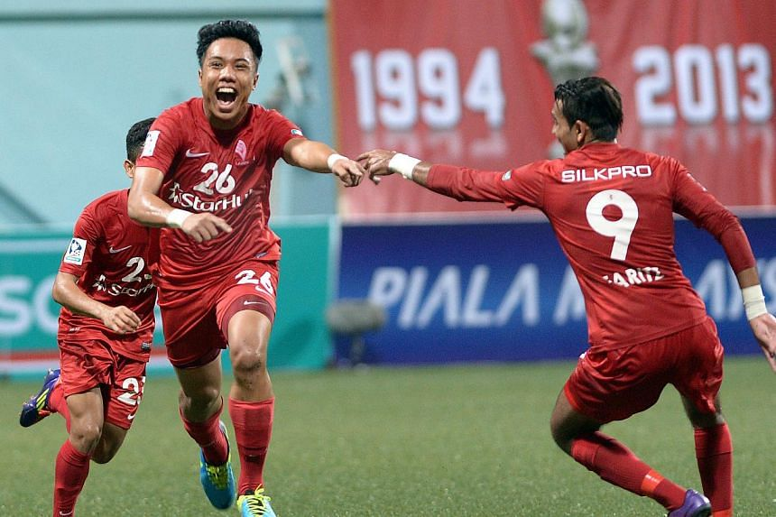 Shahfiq Ghani (centre) celebrates his goal with Faritz Hameed. The forward scored with a25-metre free kick but the LionsXII could only draw 2-2 against Kedahin their opening Malaysia Cup Group D match at Jalan Besar Stadium on Tuesday, Au