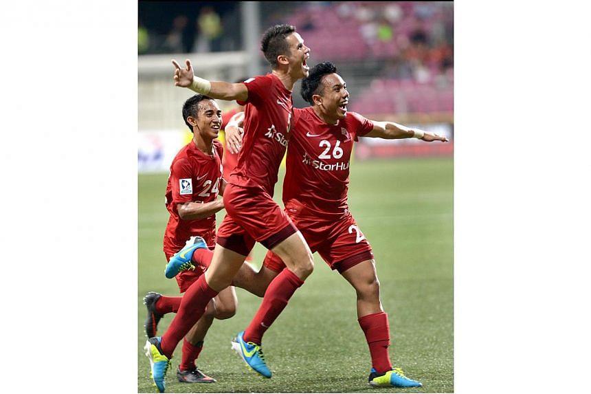 (From left) LionsXII players Faris Ramli, Baihakki Khaizan and Shahfiq Ghani celebrate Shahfiq's goal against Kedah.-- ST PHOTO: LIM SIN THAI