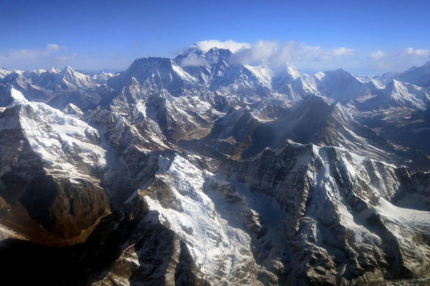 This file photograph taken on April 3, 2013, from an aircraft shows an aerial view of Mount Everest (centre) and the Himalayan mountain range, some 140km north-east of Kathmandu. Nepal will open five more peaks above 8,000m for expeditions when the a