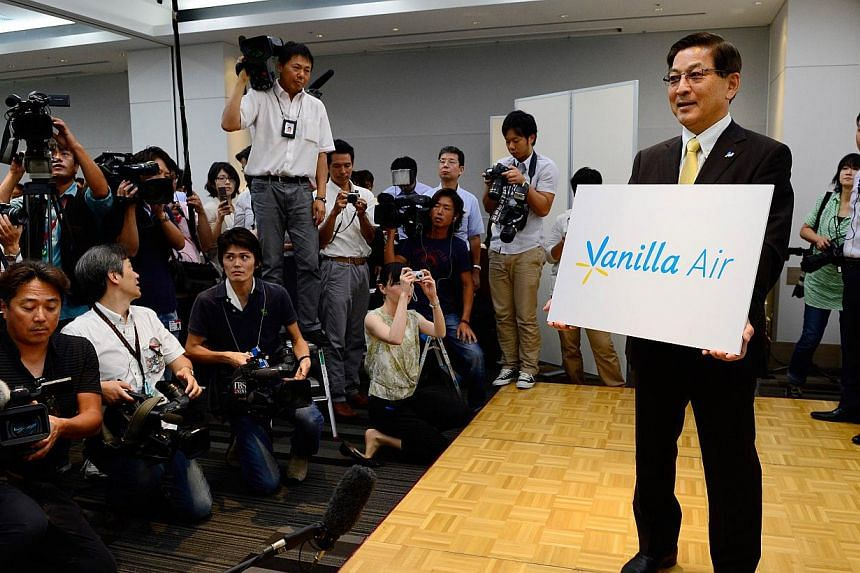 AirAsia Japan president Tomonori Ishii unveils its new brand name Vanilla Air during a press conference in Tokyo on Tuesday, Aug 20, 2013. The budget carrier is being rebranded, the airline announced on Tuesday, with its president saying that vanilla