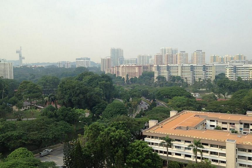 Slightly hazy view in the west on Tuesday morning. Residents in the east woke up to the smell of smoke in the air on Tuesday morning, with many wondering if the haze was back after a two-month hiatus. -- ST PHOTO: DERRICK HO
