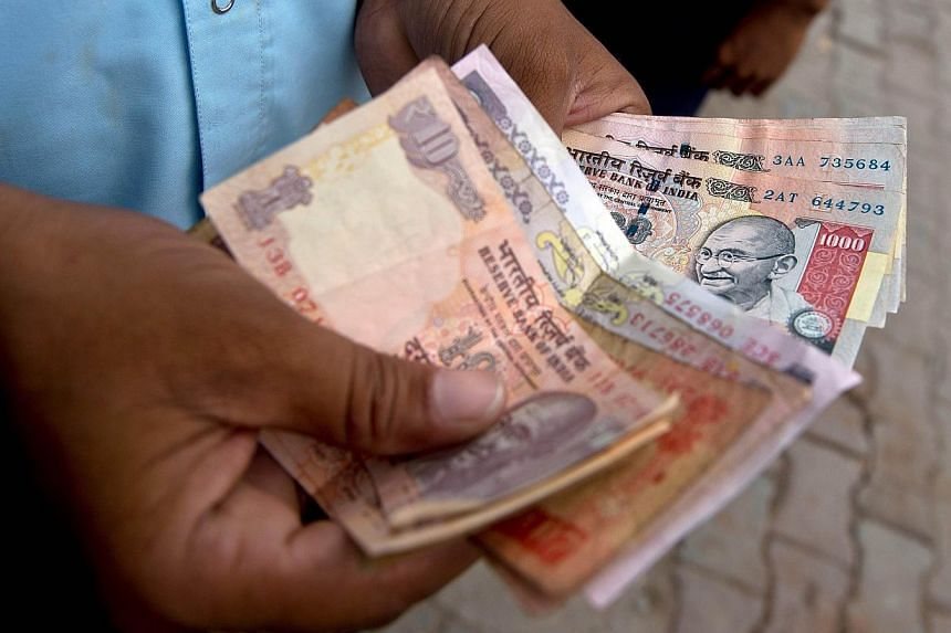 India's rupee hit a new all-time low against the dollar on Tuesday on continuing fears that recent measures to stabilise the currency and kickstart the flagging economy will not work. -- FILE PHOTO: AFP