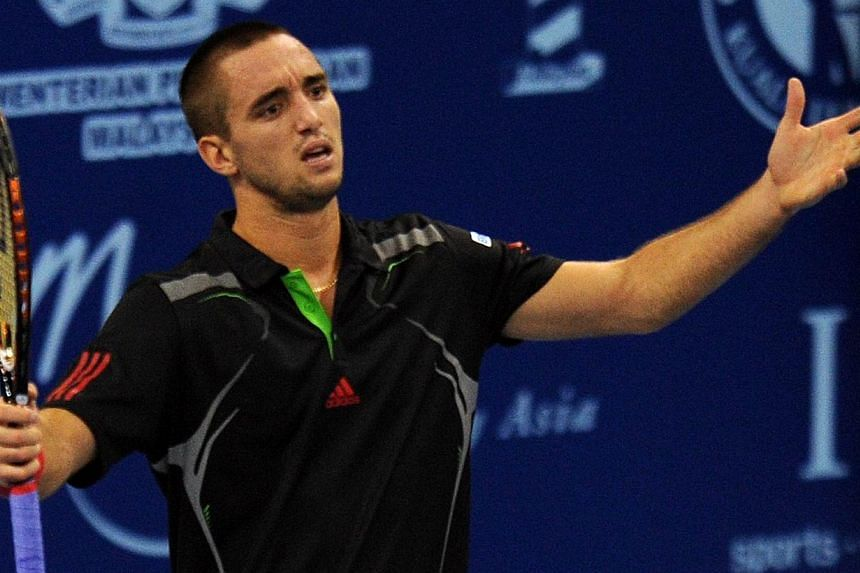 Serbia's Viktor Troickireacts after losing a point during a men's semi-final match at the ATP Malaysia Open in Kuala Lumpur on Oct 1, 2011. Troickihas turned to the Court of Arbitration for Sport (CAS) in his drive to overturn an 18-month