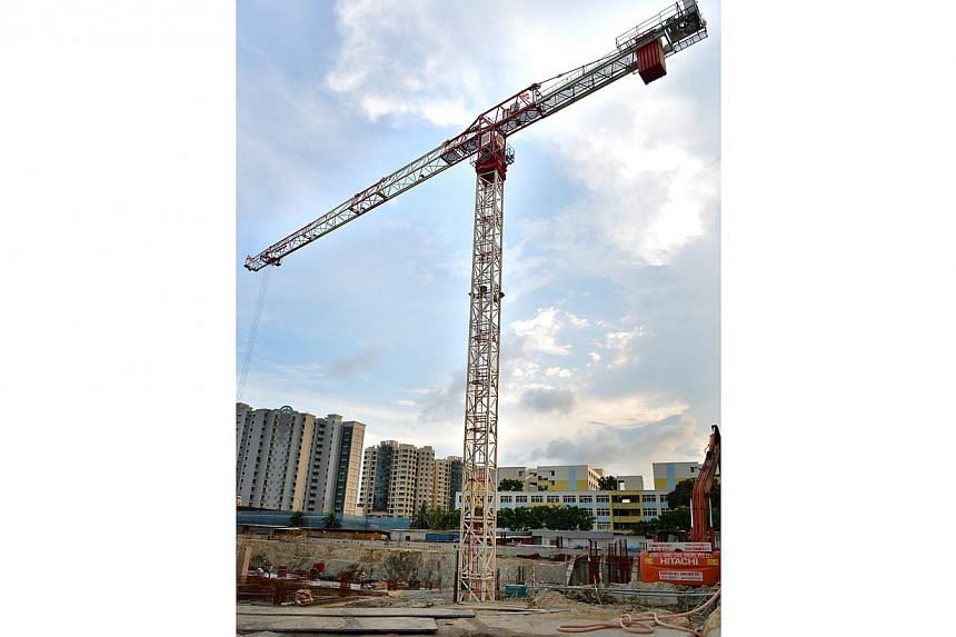 A tower crane at a Paya Lebar construction site. Moving the Paya Lebar Airbase to Changi could see height restrictions relaxed in several districts in the northeast and east and boost transport connectivity across the island, the Ministry of Nat