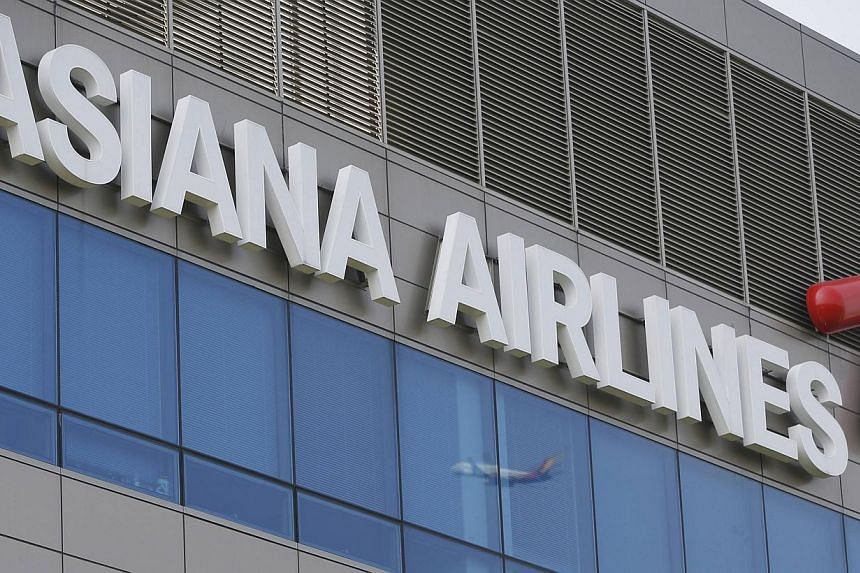 Asiana Airline's head office in Seoul on Aug 8, 2013. South Korea's second-largest carrier Asiana Airlines said on Wednesday it was cancelling charter flights to Fukushima in Japan from October due to radiation fears from the crippled nuclear plant t
