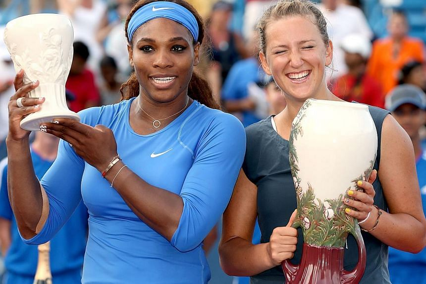 Serena Williams and Victorioa Azarenka of Belarus poses for photographers at the trophy ceremony during the final of the Western Southern Open on Aug 18, 2013 at Lindner Family Tennis Center in Cincinnati, Ohio. Williams has been given the top seedin