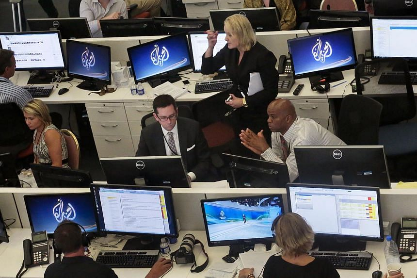 Al-Jazeera America editorial newsroom staff prepare for their first broadcast on Aug 20, 2013, in New York. The Qatar-based Al-Jazeera Media Network launched its United States Al-Jazeera America went live on Tuesday, accompanied by a campaign of trad
