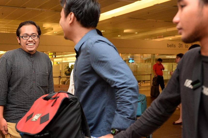 Mr Firdaus Azhari (left) was welcomed by a group of friends at Changi Airport this morning. Singaporean students studying in Egypt arrived in Singapore on Wednesday morning, having evacuated the country following unrest and mass demonstrations that h