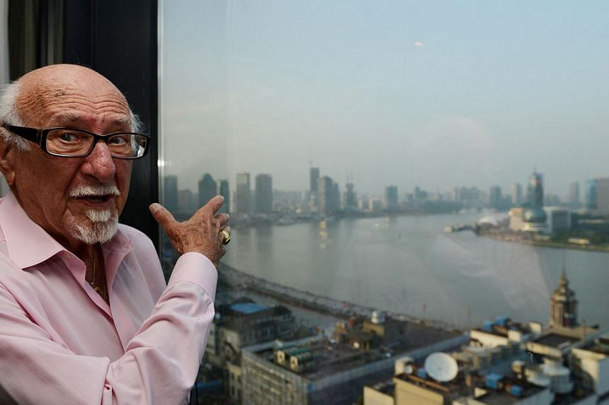 This photo taken on May 28, 2013, shows 92-year-old Gary Matzdorff talking to Agence France-Presse in his hotel room as he looks out at the Pudong area of Shanghai. It was more than 70 years ago that Mr Matzdorff, a Jewish refugee, escaped Nazi Germa