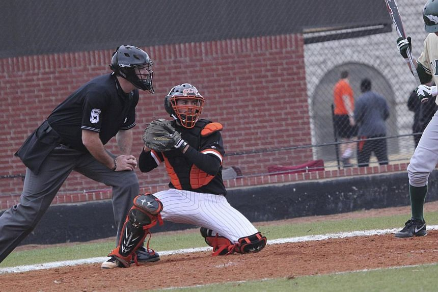 Australian college student Christopher Lane is pictured playing catcher in this undated handout photo. Lane, who played baseball for East Central University in Ada, Oklahoma, was shot and killed in Duncan, Oklahoma on Aug 16, 2013 in a random shootin