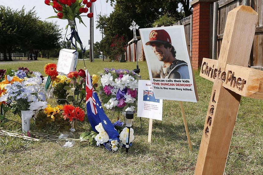 A memorial to Christopher Lane is shown on Tuesday, Aug 20, 2013, along the road where he was shot and killed, in Duncan, Oklahoma. Lane, an Australian who was on a baseball scholarship at East Central University in Ada, Oklahoma, was in Duncan visit
