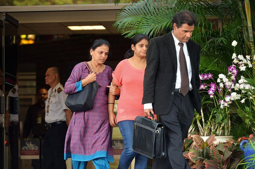 Madam Selvi Narayanasamy (left), the mother of an inmate who died in prison three yearsago, leaves the Subordinate Court Building on July 19, 2013. She filed an affidavit with the High Court on Wednesday, Aug 21, 2013, seeking a mandatory order