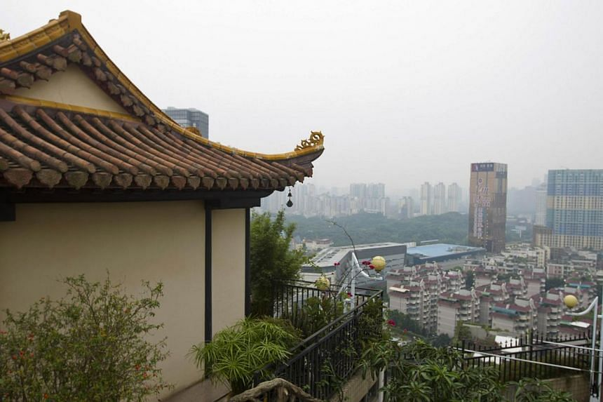 A temple is seen on the rooftop of a 21-storey apartment building in Shenzhen, south China's Guangdong province on Wednesday, Aug 21, 2013. Tight security prevents public access to the rooftop temple, with a fingerprint lock and cameras installed.&nb