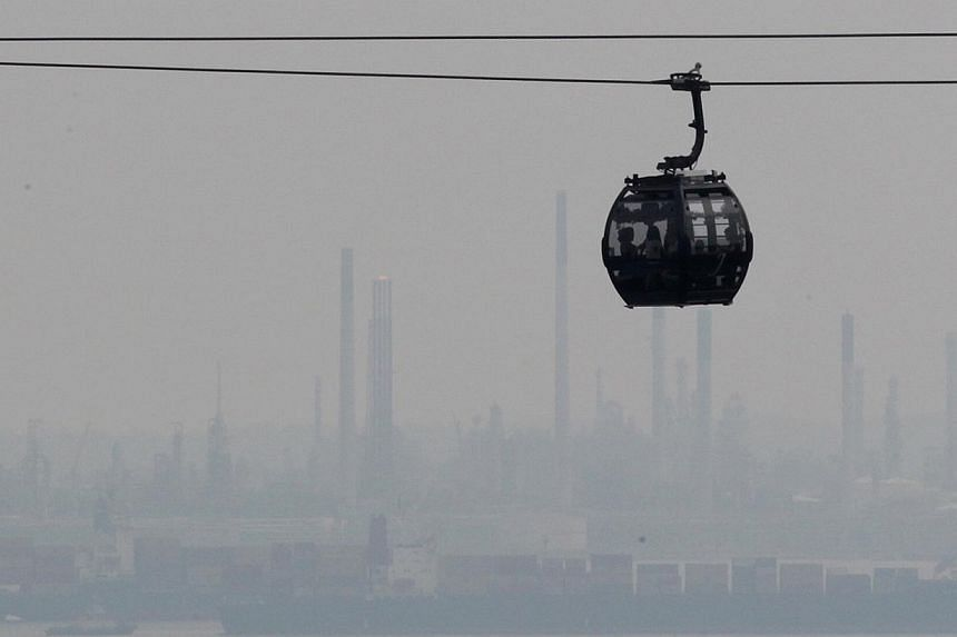 The haze was clearly visible at 2pm yesterday in the area between Mount Faber and Sentosa, with ships shrouded in the background. The PSI reading of 56 was the highest since a June 30 reading of 71, but relatively low compared with levels on June 21,