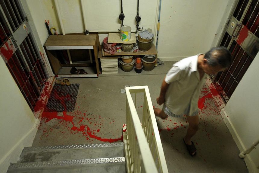 Red paint splashed on a debtor's neighbours' doors to pressure the debtor to pay up.