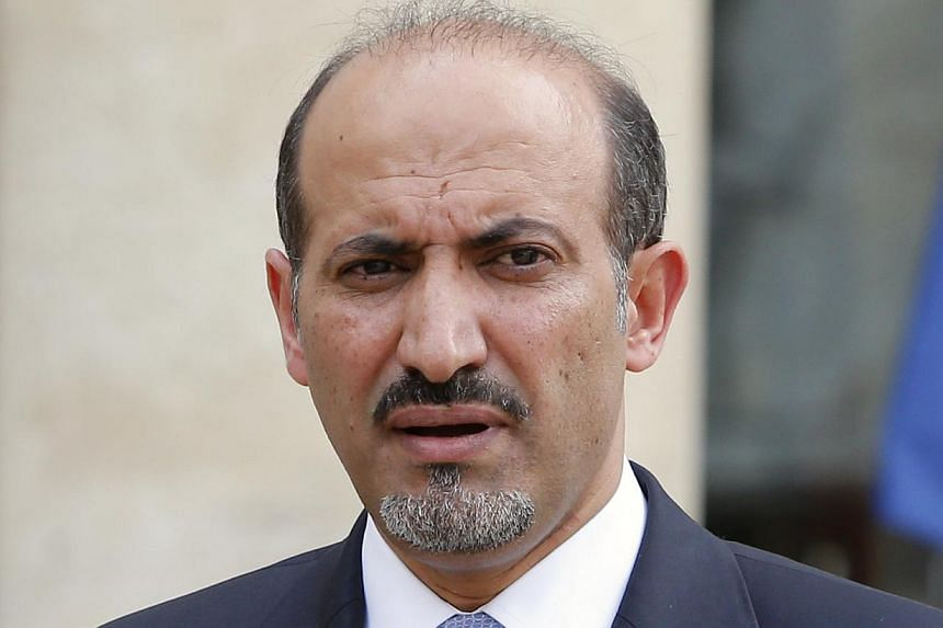 The opposition Syrian National Coalition'sleader Ahmed al-Jarba (above)called for an urgent UN Security Council meeting after at least 100 people reportedly died in an alleged toxic gas attack by the army on Wednesday.-- FILE PHOTO: