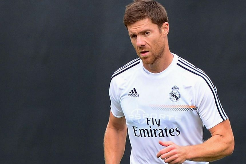 Real Madrid midfielder Xabi Alonsowarms up during a morning training session at UCLA on July 30, 2013, in Los Angeles, California.Real Madrid midfielder Xabi Alonso could be out for up to three months after breaking a bone in his foot dur