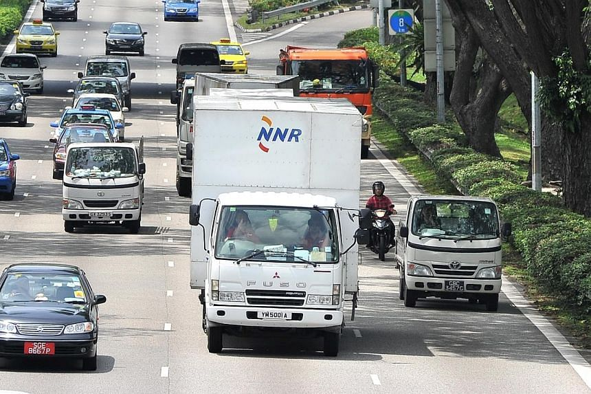 Certificates of entitlement for commercial vehicles breached the $70,000-mark to set yet another record at the latest tender on Wednesday, Aug 21, 2013.-- FILE PHOTO:LIM YAOHUIFOR THE STRAITS TIMES