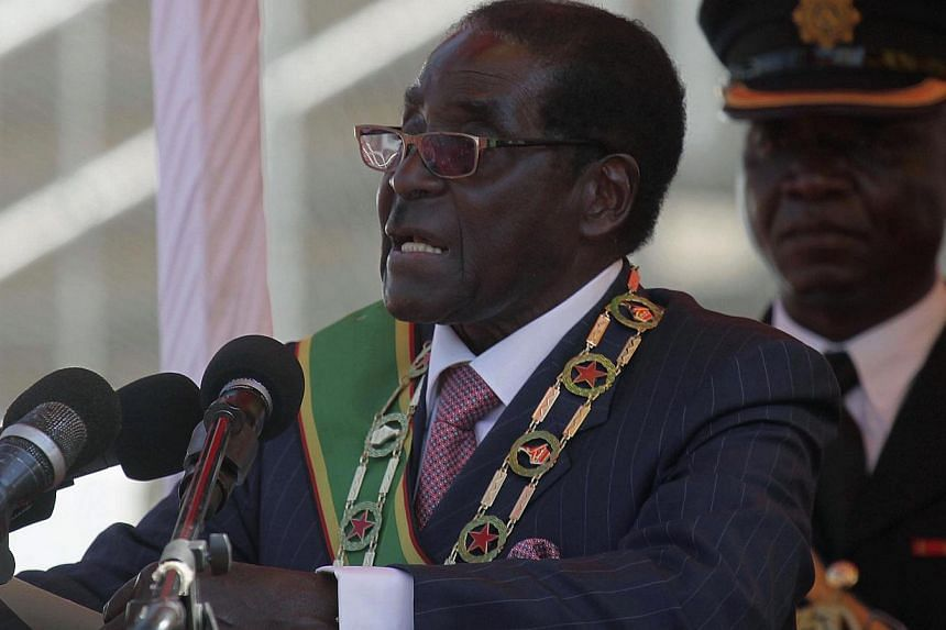 Zimbabwe's President Robert Mugabe addresses supporters during celebrations to mark the country's Defence Forces Day in the capital Harare, on Aug 13, 2013. Mr Mugabe, who will extend his 33-years in power on Thursday, once quipped he would rule his