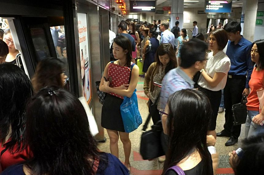 Surveyors interviewed commuters aged 15 and above at bus interchanges and MRT stations islandwide in June and last month. -- ST PHOTO: NURIA LING
