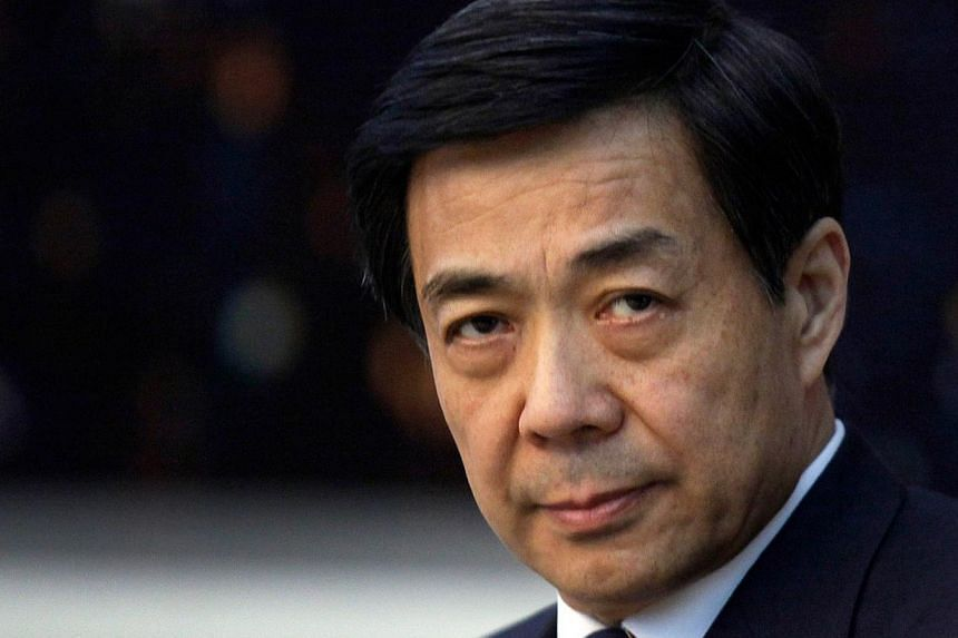China's then Chongqing Municipality Communist Party Secretary Bo Xilai looks on during a meeting at the annual session of China's parliament, the National People's Congress, at the Great Hall of the People in Beijing, on March 6, 2010. The long-await