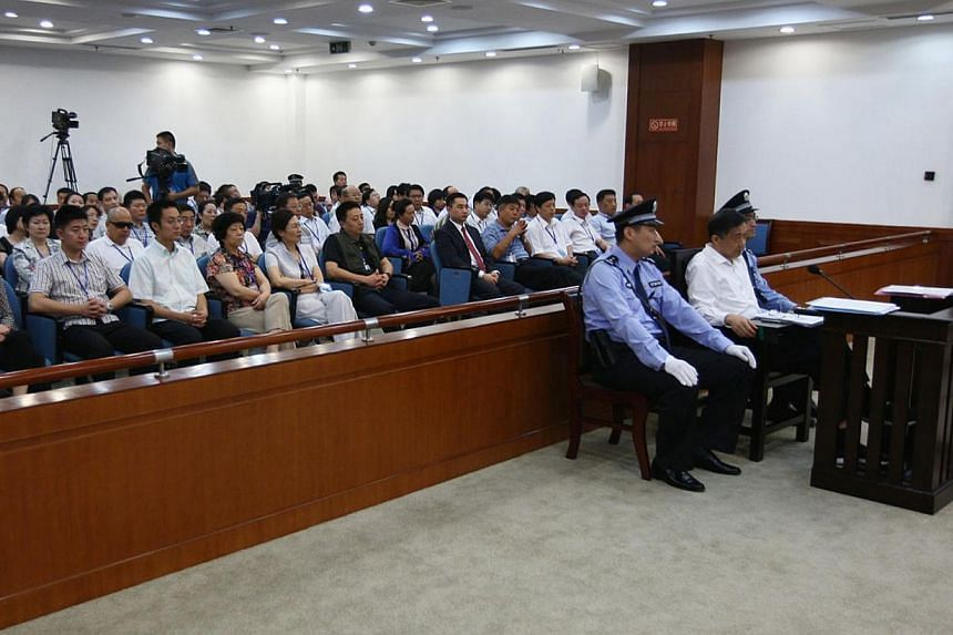 Disgraced Chinese politician Bo Xilai stands trial inside the court in Jinan, Shandong province on Aug 22, 2013, in this photo released by Jinan Intermediate People's Court. Charges against Bo was heard this morning at the Jinan Intermediate People's