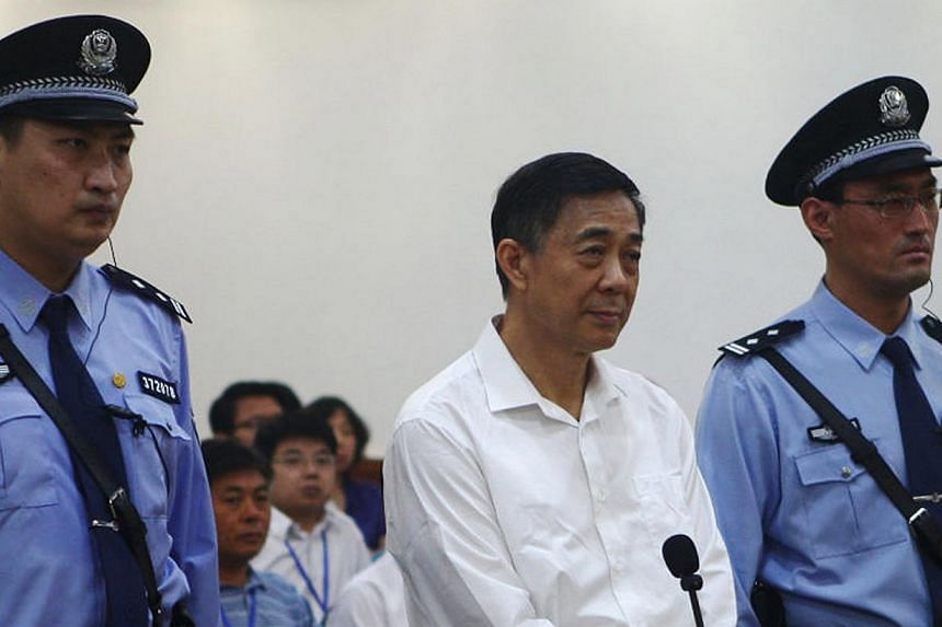 Disgraced Chinese politician Bo Xilai stands trial inside the court in Jinan, Shandong province on Aug 22, 2013, in this photo released by Jinan Intermediate People's Court. The sensational trial with him disputing a bribery charge, one of three crim