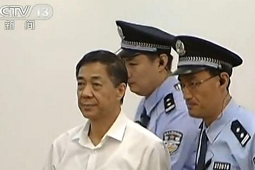 This screen grab taken from CCTV footage on Thursday, Aug 22, 2013, shows ousted Chinese political star Bo Xilai being escorted by policemen as he enters the courtroom to stand on trial in the Intermediate People's Court in Jinan, in eastern China's