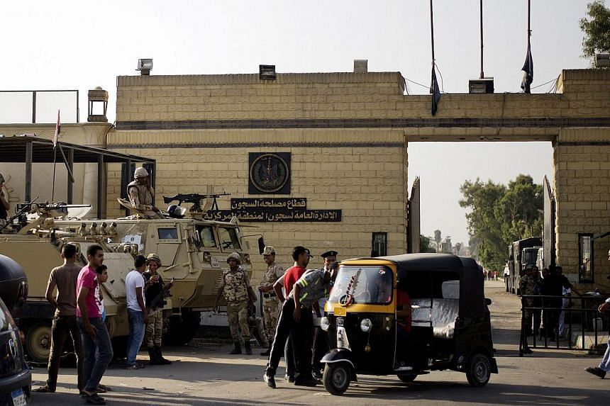 Members of Egyptian security forces stand guard outside one of the gate of the Tora prison where former Egyptian president Hosni Mubarak is detained on Aug 21, 2013, in Cairo, Egypt. -- FILE PHOTO: AFP