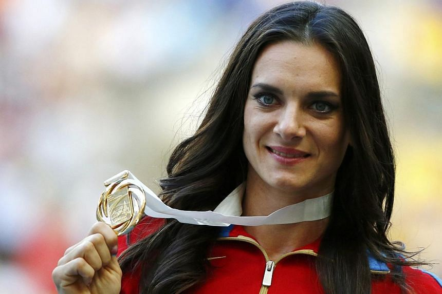 World champion Yelena Isinbayeva of Russia holds her medal at the women's pole vault victory ceremony during the IAAF World Athletics Championships at the Luzhniki stadium in Moscow on Thursday, Aug 15, 20130. Russia's triple pole vault world ch